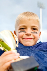 Young football player wearing eye black