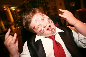 Kid enjoying temporary tattoos at wedding