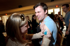 Applying a temporary tattoo at Wine Riot