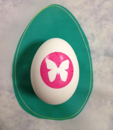 Beautiful Easter egg decorated with pink butterfly temporary tattoo