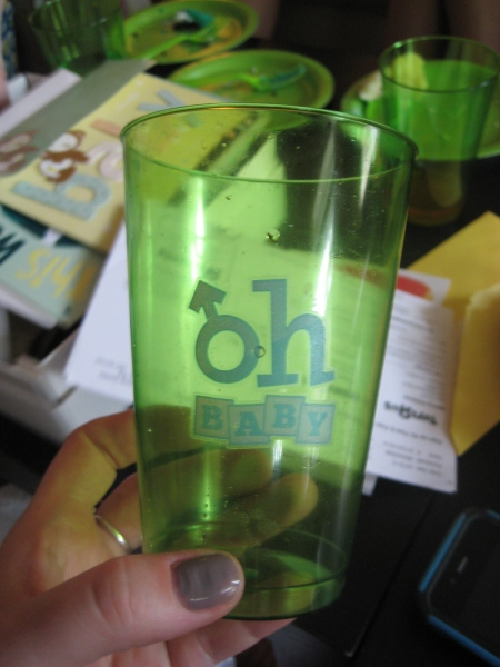 Baby shower tattoos decorate cups at party