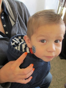 face paint temporary tattoo kid at party